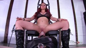 Dominating a redheaded titty gal over a dull slave